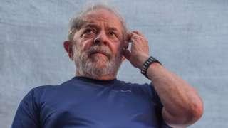 Former President Luiz Inacio Lula da Silva gestures to supporters