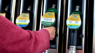 Person at petrol pump