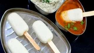 Idli, a steamed rice cake, served on an ice-cream stick