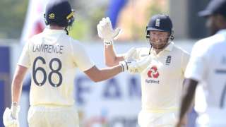Dan Lawrence and Jonny Bairstow celebrate England's seven-wicket win