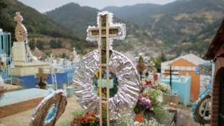 A view of the grave of Raul Hernandez, a tour guide working at a famous butterfly reserve in the western state of Michoacan, Mexico