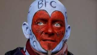 A Burnley fan in face paint