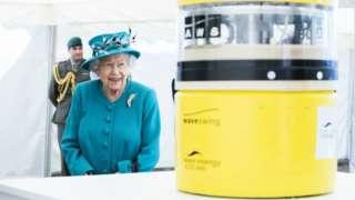 Queen Elizabeth is shown a wave energy converter model