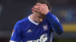 Ipswich's Callum Connolly holds his head