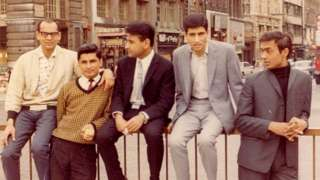 Praful's YMCA friends sitting on the railings at Piccadilly Circus