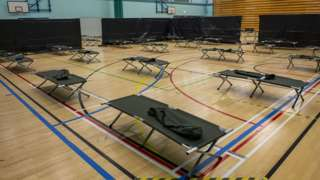 Wide shot of beds in gym