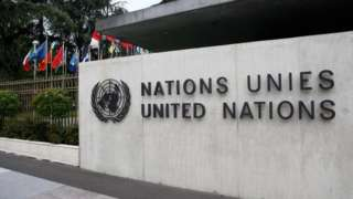 The United Nations emblem is seen in front of the United Nations Office in Geneva, Switzerland