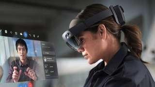 An engineer wearing a HoloLens 2 headset