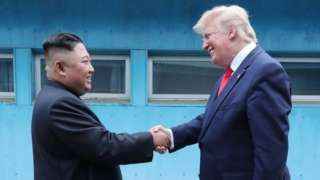 Kim Jong-un and Donald Trump shake hands at the DMZ (30 June 2019)