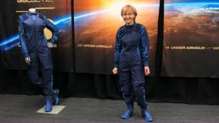 Ketty Maisonrouge trying on her spacesuit for the first time