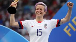 Megan Rapinoe with trophy