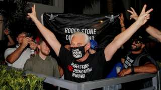 Roger Stone reacts to the news of the commutation of his sentence, outside his home in Fort Lauderdale