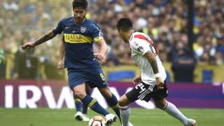 Enzo Perez and Pablo Perez battle for the ball