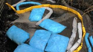 Bags to collect oil which has seeped into the River Yare, Norwich