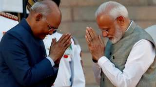 "India's President Ram Nath Kovind greets India""s Prime Minister Narendra Modi after his oath during a swearing-in ceremony at the presidential palace in New Delhi, India May 30, 2019"