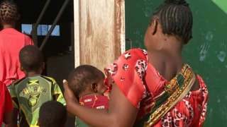 A woman in Pemba who was kidnapped by al-Shabab and her children - Pemba, Mozambique, September 2021