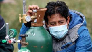 Man in Peru with mask and oxygen tank