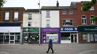 A pedestrian walks through Barrow town centre