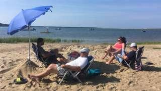 Zoe Fishman and family sunbathe on Cape Cod