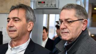 Pascal Fauret (R) and Bruno Odos, respectively pilot and co-pilot arrive on February 18, 2019 at the Assize Court of Aix-En-Provence