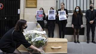 Members of RSF, Reporters Sans Frontieres (Reporters Without Borders) carry a mock coffin and pages of Hong Kong-based Apple Daily newspaper, during a protest against the closure of the newspaper, outside the Chinese Embassy in Paris, France, 25 June 2021.
