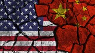 American and Chinese flags painted on cracked wall background