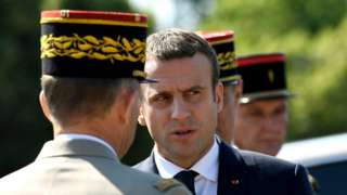 "French President Emmanuel Macron (C) speaks to an official during a ceremony marking to mark the 77th anniversary of General Charles de Gaulle""s appeal of 18 June 1940, at the Mont Valerien memorial in Suresnes, near Paris, France, 18 June 2017"