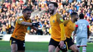 Josh Sheehan celebrates after scoring for Newport