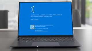 Stock image composite of the blue screen on a laptop