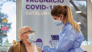 An elderly person receives the coronavirus disease vaccine at resident Gent Gran Creu, in Girona, Catalonia, Spain, 27 December 2020