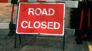 Road closed sign - stock image
