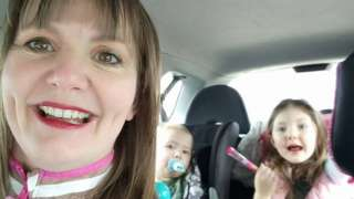 Sam McConnell with her children in a car