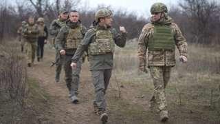 President Zelensky (front L) visited Ukrainian troops in the conflict zone on 8-9 April