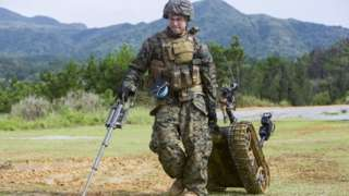 Solider dragging a robot