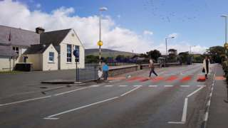 Artist's impression of red and black zebra crossing