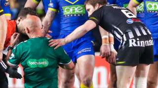 Referee Phil Bentham receives treatment after his collision with Chris Houston