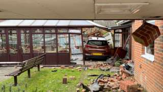 car in conservatory