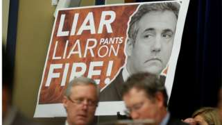 "Congressman Paul Gosar held up a large sign with ""Liar, Liar, Pants on Fire!!"" emblazoned over a picture of Michael Cohen."
