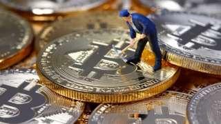 Mini figure of a bitcoin miner