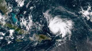 In this NOAA GOES-East satellite image, Hurricane Dorian leaves the Caribbean Sea and tracks towards the Florida coast taken at 14:20 UTC August 29, 2019 in the Atlantic Ocean.