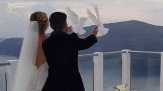 Sam and Laura release doves on their wedding day
