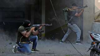 Shia militia fighters fire rifles and rocket-propelled grenades during clashes near the Palace of Justice in Beirut, Lebanon (14 October 2021)