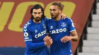 Dominic Calvert-Lewin (R) celebrates with Everton's Portuguese midfielder Andre Gomes (L)