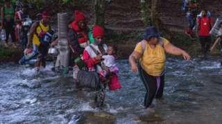 Haitian migrants crossing the Panama-Colombia border
