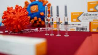 "A display shows vaccine products of Sinovac Biotech during a government-organized media tour showcasing the company""s development of a coronavirus disease (COVID-19) vaccine candidate in Beijing, China, September 24, 2020."