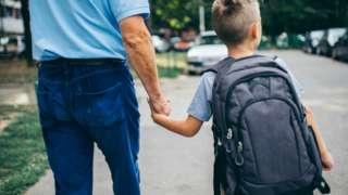 Stock image of boy walking to school