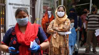 People with coronavirus symptoms wait in queue for a COVID-19 test at an ayurvedic hospital during a lockdown imposed as a preventive measure against the spread of the COVID-19 coronavirus in New Delhi on May 29, 2020.
