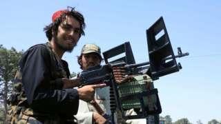 Taliban forces patrol a street in Herat, Afghanistan