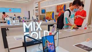 Xiaomi's first Mix foldable smartphone and Redmi K40 at the store in Shanghai, China.