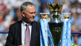 Richard Scudamore with the Premier League trophy